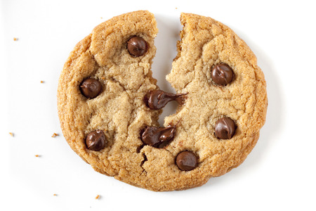 chocolate chip cookie being split in the middle, chocolate chip is melting.