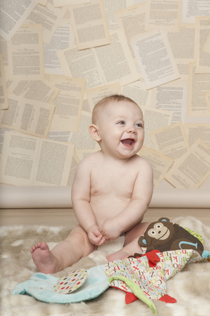 six months: Baby Learning to Read