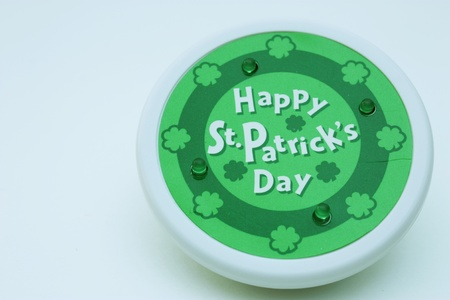Happy St. Patricks Day button isolated on white background photo