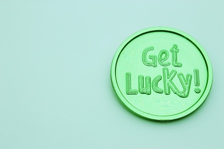 lucky clover: Green get lucky coin isolated on white background for St. Patricks Day Stock Photo