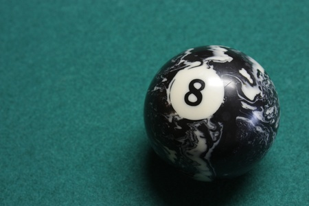 Closeup of the eight ball on the pool table photo
