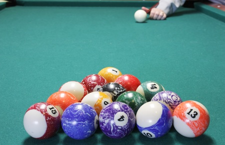 Lining up the que ball to break in a game of pool photo