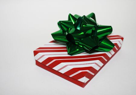 beautifully wrapped: A beautifully wrapped Christmas present with a big green bow on top