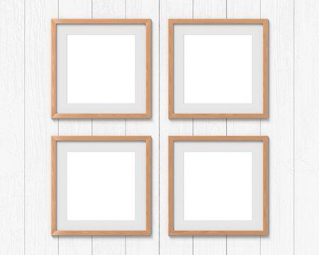 Set van 4 vierkante houten frames mockup met een rand aan de muur. Lege basis voor afbeelding of tekst. 3D-weergave. Stockfoto