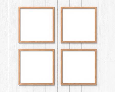 Set van 4 vierkante houten frames die aan de muur hangen. Lege basis voor afbeelding of tekst. 3D-weergave.