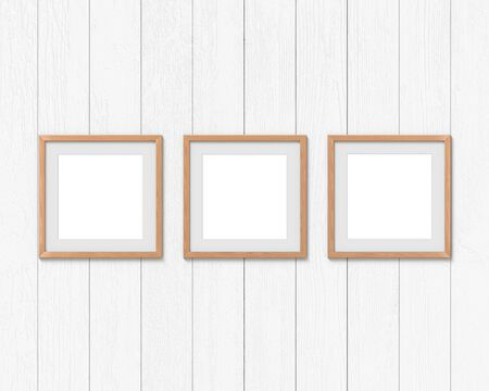 Set of 3 square wooden frames mockup with a border hanging on the wall. Empty base for picture or text. 3D rendering.