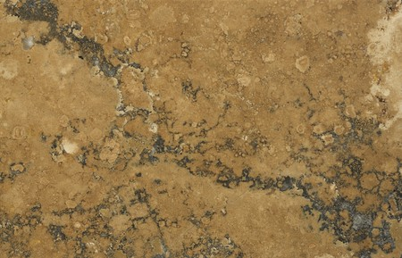 amber coloured: Surface of the stone. Travertine. Rust-coloured pattern. Stock Photo
