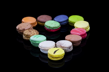 close up shot of various kind of fresh macaroons arrangement,Heart shaped  Stock Photo