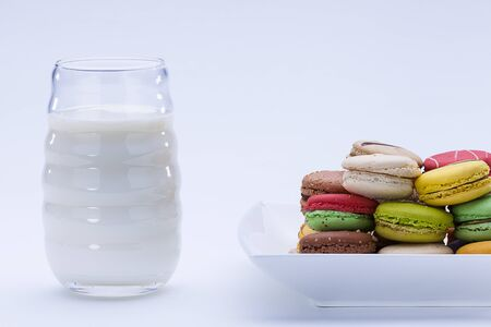 close up shot of various kind of fresh macaroons arrangement with a glass of milk  Stock Photo - 16974914