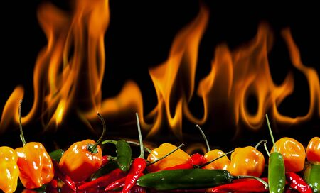 black pepper: yellow habanero pepper,green jalepeno,red pepper cayenne with real flame background