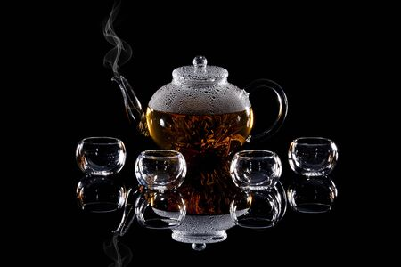 Chinese teapot glass on a black background