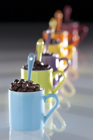 vue: set of multicolored cappuccino cup with reflection on a black background