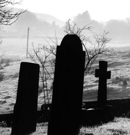 gravestones covered with mist Stock Photo