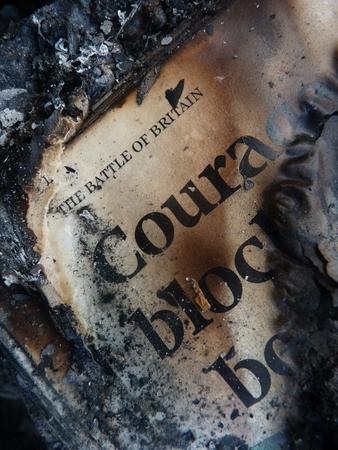 firestarter: burnt newspaper courage word