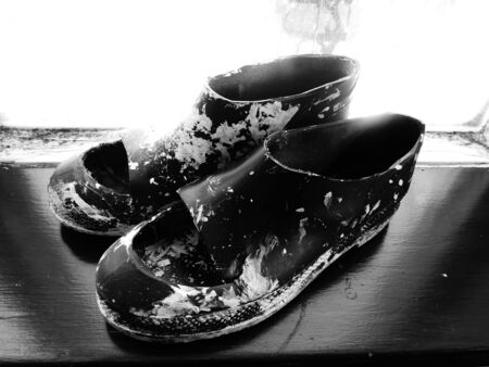 foot ware: paint spattered shoes on wood
