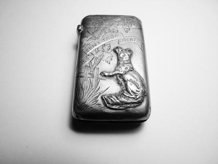 silver fox: fox on an antique silver vesta case Stock Photo