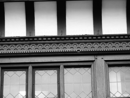 heads old building facade: chester tudor building detail window