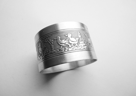 napkin ring: sterling silver cute duckling napkin holder Stock Photo