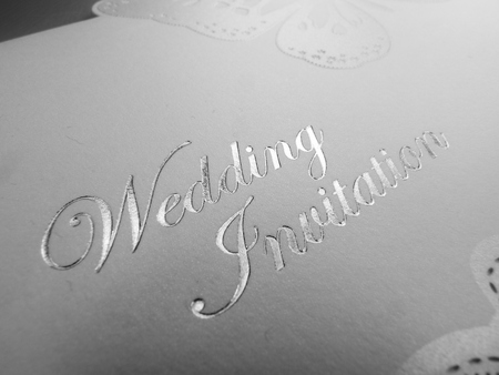 engraver: silver and white wedding invitation