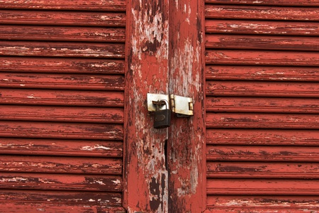 Old door red wood  peeling paint and key Stock Photo - 16914335