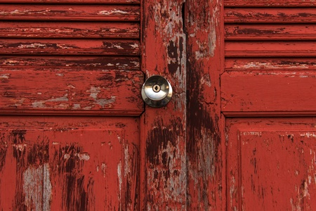 Old door red wood  peeling paint and knob Stock Photo - 16914331