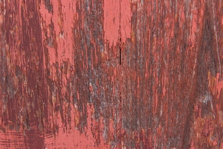 close-up red wood  peeling paint photo