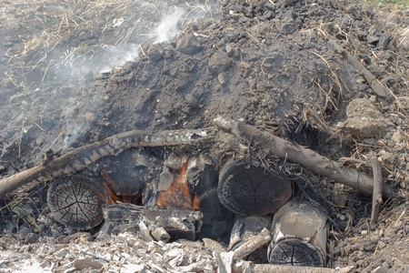 volatile: Charcoal burning In Thailand,Charcoal is a light black residue consisting of carbon, and any remaining ash, obtained by removing water and other volatile constituents from animal and vegetation substances  Stock Photo