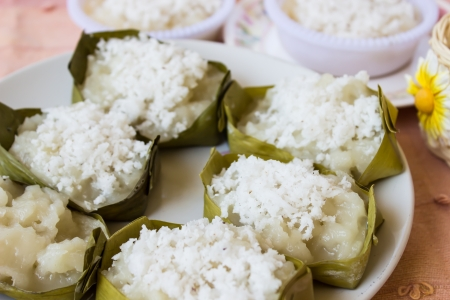 Traditional Thai dessert, made from Wax gourd or Chalkumra, sugar, and coconut milk, wrap with banana leaf  Stock Photo