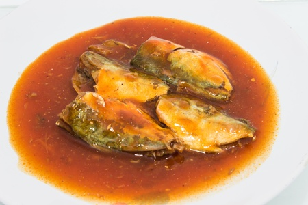Canned fish in tomato sauce on dish