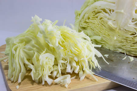 Sliced cabbage ,Shredded cabbage on the board  Isolated