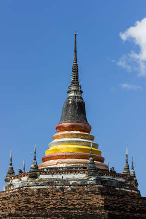 Top of the stupa in Thailand and blue sky
