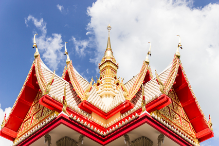 Gable apex of Thai temple and blue sky Stock Photo