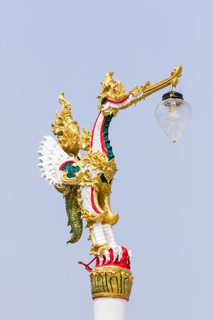 Thai art style light pole Thai golden swan in literature at temple. Stock Photo