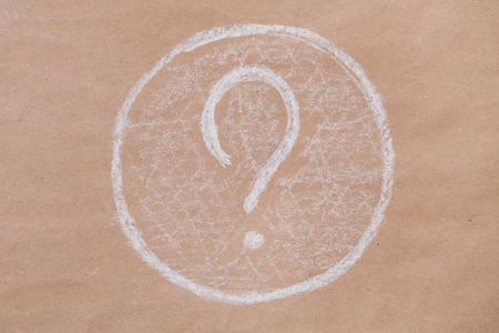 Question mark. Background of old kraft paper. copy space