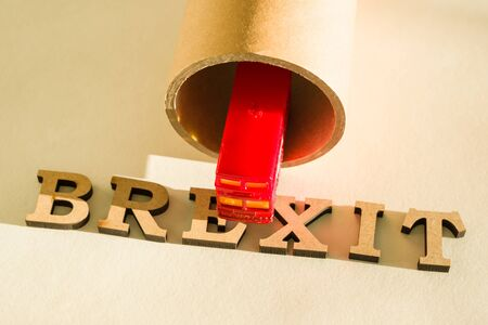 Britain exit from European Union, Brexit word abstract in vintage letters, background double decker bus toy model, tunnel Stock Photo