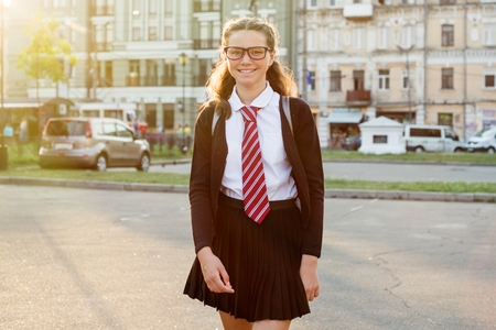 Girl teenager high school student in the city street Stock Photo
