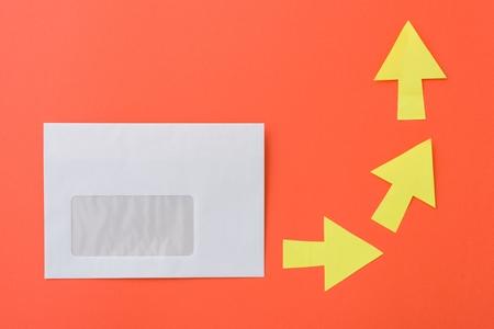 White envelope with arrows