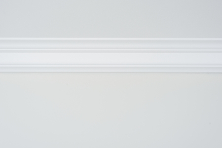 Ceiling moldings in the interior, detail of a flat ceiling skirting.