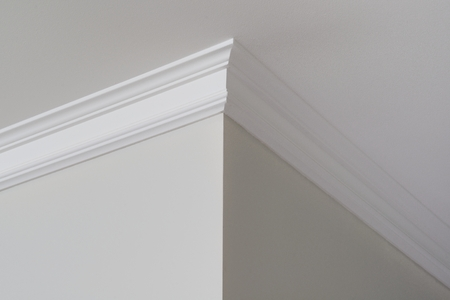 Ceiling moldings in the interior, a detail of corner.