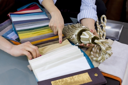 Interior Designer Shows Samples Of Interior Fabrics. Selection Fabrics For  Curtains, Bedspreads, Pillows