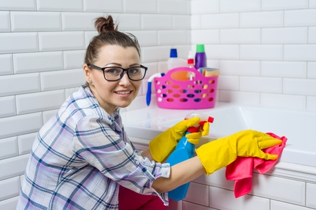 House cleaning. Woman is cleaning in the bathroom at home