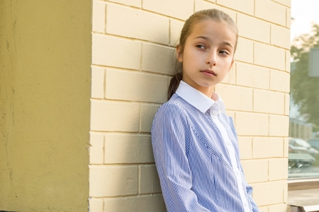 Portrait of attractive girl of 10-11 years old. Standard-Bild