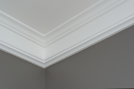 Details in the interior close-up. Ceiling moldings, part of intricate corner