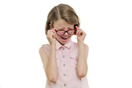 Little girl child in glasses screaming, crying, closing her eyes, isolated on white.