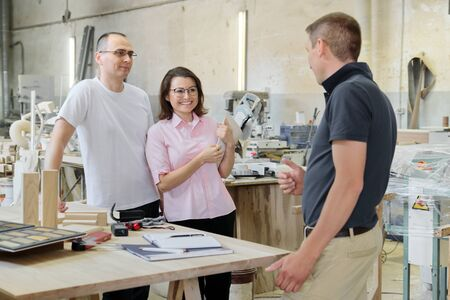Customers and a carpentry workshop engineer discussing wooden products. Stok Fotoğraf