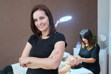 Portrait of woman cosmetologist at beauty clinic. People, beauty, cosmetology and skincare concept