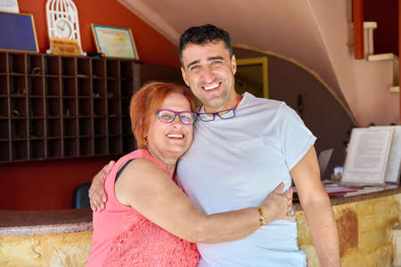 Portrait of happy elderly 70s mother and middle-aged son Stock fotó