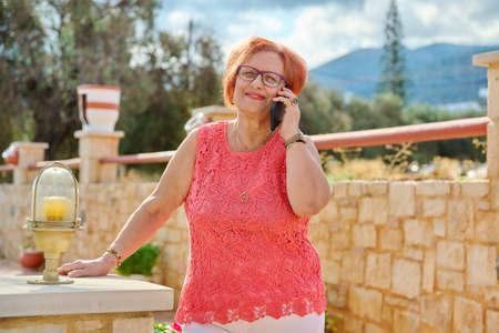 Elderly 70s woman talking on the phone
