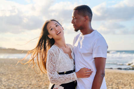 Portrait of a happy young beautiful couple on the beach