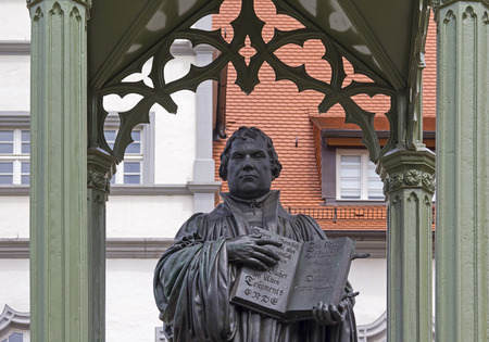 Monument of Martin Luther in Wittenberg, Germany. It was the first public monument of the great reformer, designed in 1821 by Johann Gottfried Schadow. Martin Luther was a German monk 1483-1546, theologian, and church reformer and the translator of the Bi